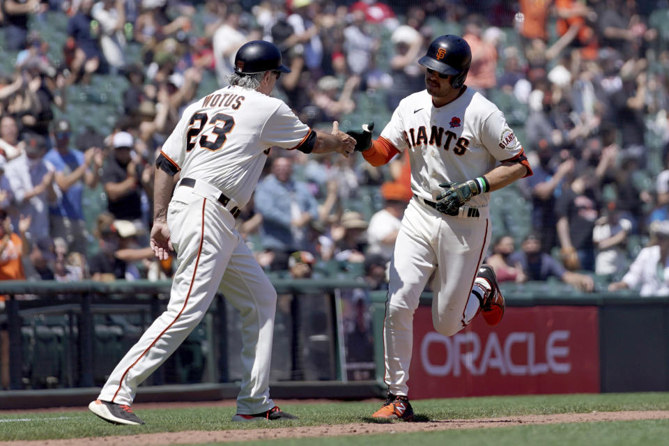 San Francisco Giants' Evan Longoria, right, is congratulated by third base coach Ron Wotus, left, as he rounds the bases after hitting a two run home run against Los Angeles Angels during the fourth inning of a baseball game Monday, May 31, 2021, in San Francisco. (AP Photo/Tony Avelar)