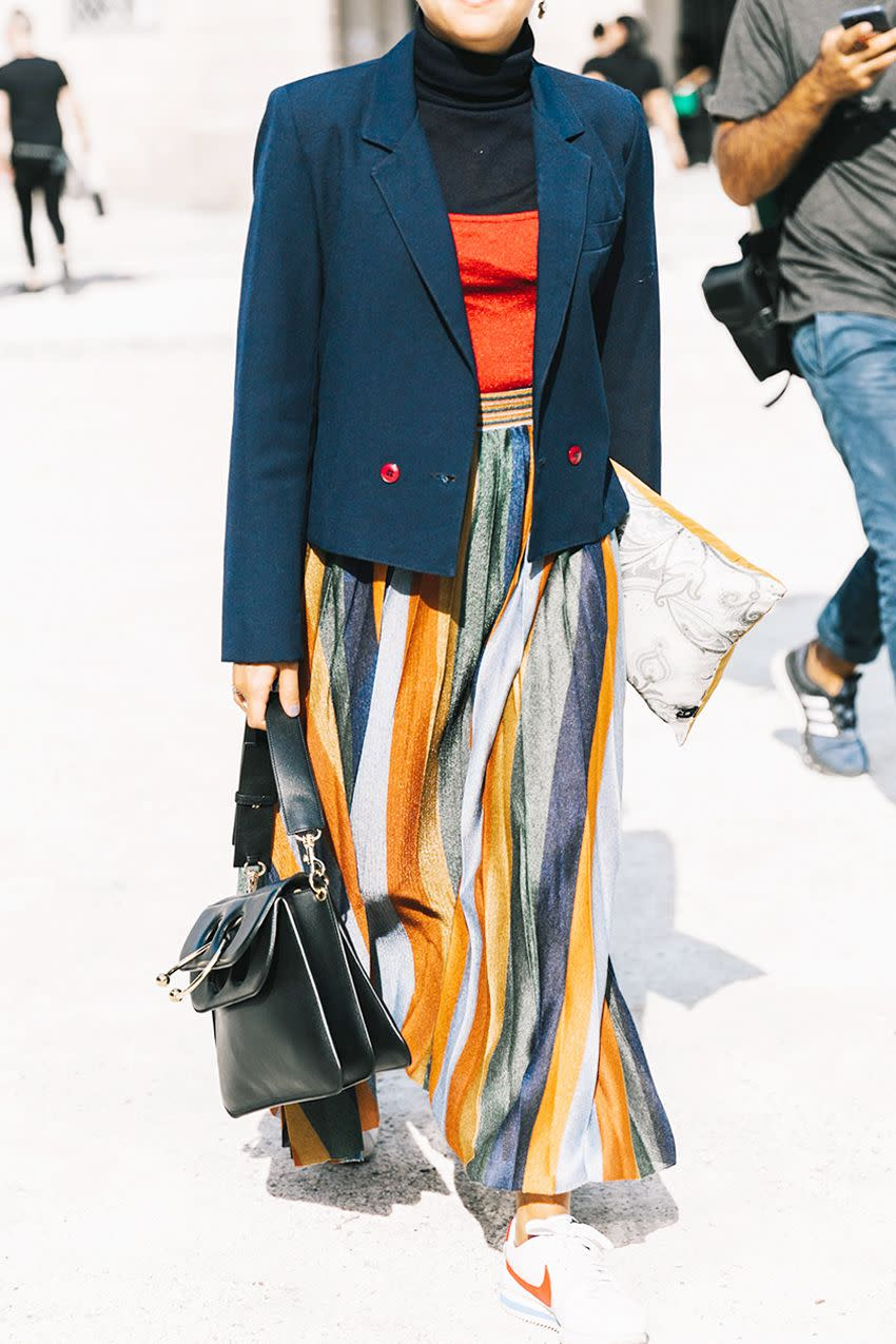 We love how this look utilizes the black turtleneck to its fullest potential. Bright colors keep the black and navy from looking anything but dull.