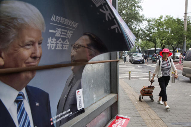 <p>A Chinese woman pulls a trolley bag past a Chinese magazine cover showing U.S. President Donald Trump and North Korean leader Kim Jong Un at a newsstand in Beijing, China, Wednesday, June 13, 2018. The outcome of the Singapore summit between President Donald Trump and North Korean leader Kim Jong Un was good news for one absent but key player: China. (AP Photo/Ng Han Guan) </p>