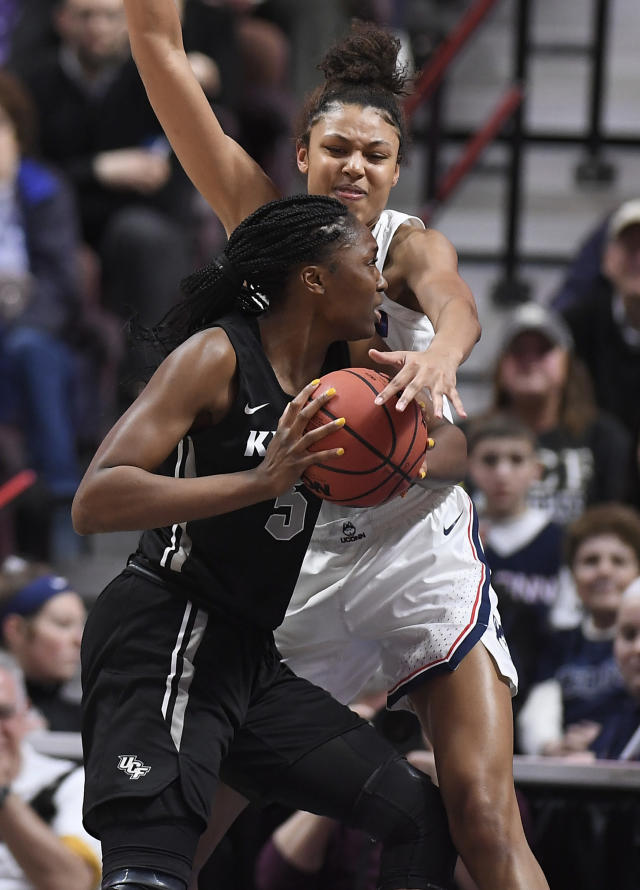 Connecticut's Olivia Nelson-Ododa pressures Central Florida's Masseny Kaba, left, during the second half of an NCAA college basketball game in the American Athletic Conference women's tournament finals, Monday, March 11, 2019, at Mohegan Sun Arena in Uncasville, Conn. (AP Photo/Jessica Hill)