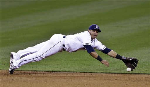 San Diego Padres shortstop Everth Cabrera makes the diving stop on a ball hit by Milwaukee Brewers' Jonathan Lucroy in the sixth inning of a baseball game in San Diego, Wednesday, April 24, 2013. Cabrera threw out Lucroy at first. (AP photo/Lenny Ignelzi)