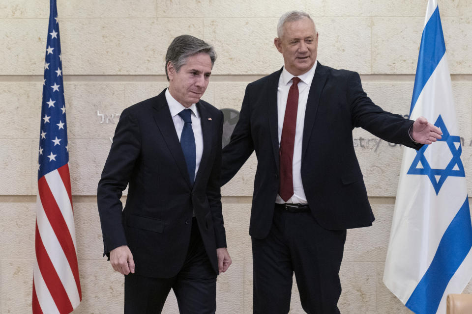 Secretary of State Antony Blinken and Defense Minister Benny Gantz move to take their seats before their meeting at the Ministry of Foreign Affairs, Tuesday, May 25, 2021, in Jerusalem, Israel. (AP Photo/Alex Brandon, Pool)