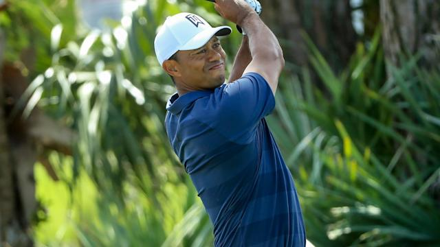 One day after he left a barrage of birdie opportunities out on the golf course, Tiger Woods worked his way into red figures early on Sunday.