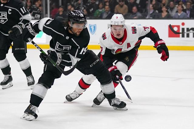 """Kings left wing Alex Iafallo, left, goes after the puck along with Ottawa Senators left wing Brady Tkachuk during the third period on March 11 at Staples Center. <span class=""""copyright"""">(Mark J. Terrill / Associated Press)</span>"""