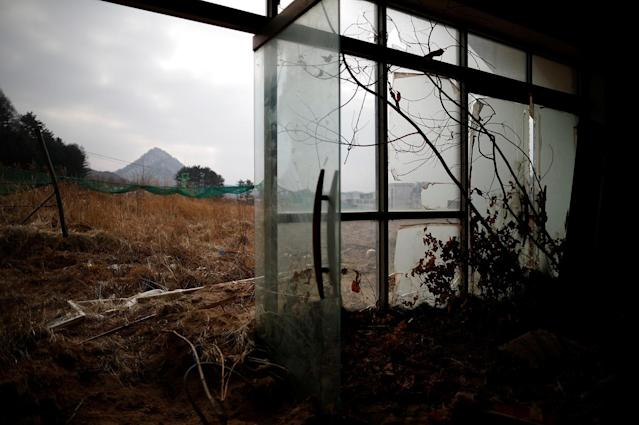 <p>Ruined entrance of the abandoned Alps Ski Resort is seen near the demilitarized zone separating the two Koreas in Goseong, South Korea, Jan. 17, 2018. (Photo: Kim Hong-Ji/Reuters) </p>