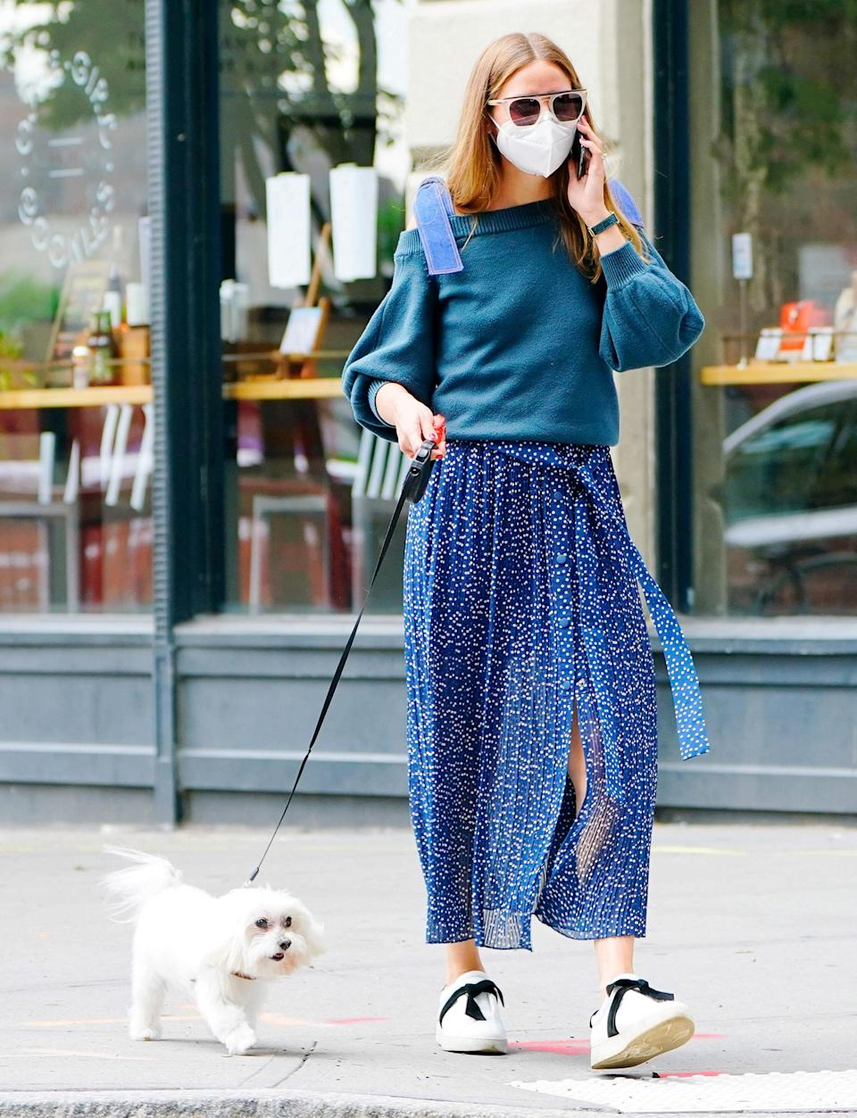 <p>Olivia Palermo keeps it stylish for a walk with her dog in N.Y.C. on Wednesday. </p>