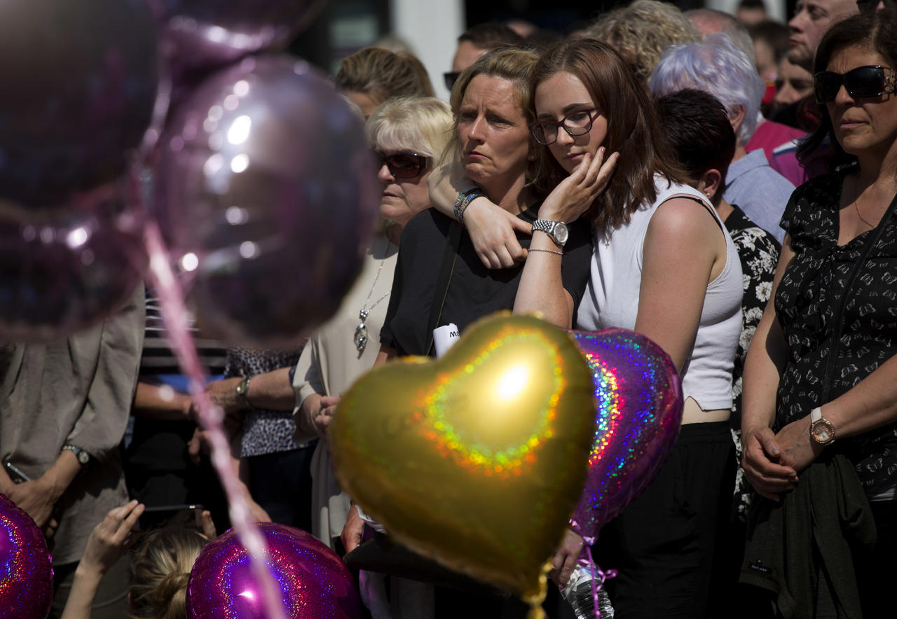 <p>People hold a minute of silence in a square in central Manchester, England, Thursday, May 25, 2017, after the suicide attack at an Ariana Grande concert that left more than 20 people dead and many more injured, as it ended on Monday night at the Manchester Arena. (AP Photo/Emilio Morenatti) </p>