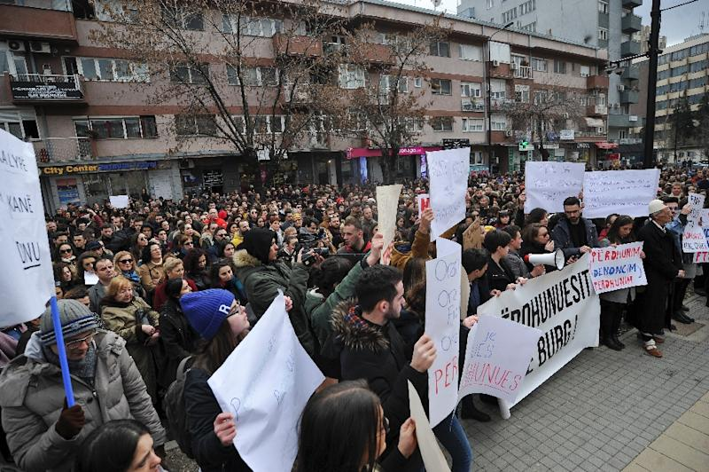 Angry protestors in the Kosovo capital Pristina demand justice for a teenager who said she was raped by her teacher and then a police officer (AFP Photo/STR)