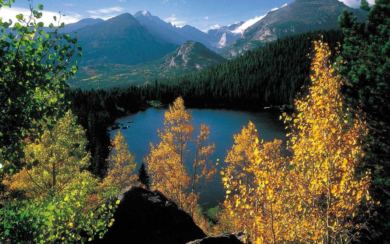 "<p>The grandeur of the <a href=""https://www.travelandleisure.com/trip-ideas/bus-train/rocky-mountaineer-adds-glass-dome-rail-cars-to-popular-western-canadian-train"" target=""_blank"">Rocky Mountains</a>, with peaks towering over 14,000 feet, is accessible by Trail Ridge Road, which crosses the Continental Divide. Go in fall, when the elk are out in big numbers for the annual mating season.</p>"