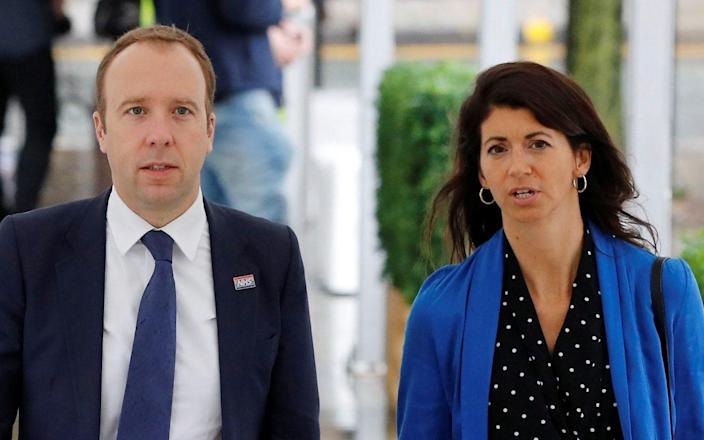 Britain's Secretary of State for Health Matt Hancock walks with his aide Gina Coladangelo outside the venue for the Conservative Party annual conference in Manchester, Britain, September 29, 2019. - Phil Noble/REUTERS