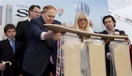 File photo of Las Vegas Sands Chairman Sheldon Adelson and his wife attending the Marina Bay Sands Casino hotel towers' topping out ceremony in Singapore