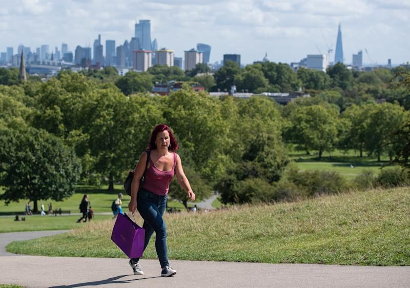 People enjoying a period of sunshine on Primrose Hill in London, as blustery showers are expected across the UK over the next few days, while hopes of a Bank Holiday heatwave have been dashed by forecasters. (Photo by Dominic Lipinski/PA Images via Getty Images)