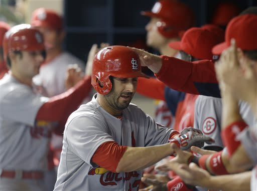 St. Louis Cardinals' Daniel Descalso celebrates in the dugout after his two-RBI home run against the Milwaukee Brewers during the seventh inning of a baseball gameon Saturday, May 4, 2013, in Milwaukee. (AP Photo/Jeffrey Phelps)