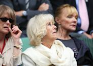 The Duchess of Cornwall looks less than impressed with the unrelenting rain during day four of the 2013 competition. <em>[Photo: Getty Images]</em>