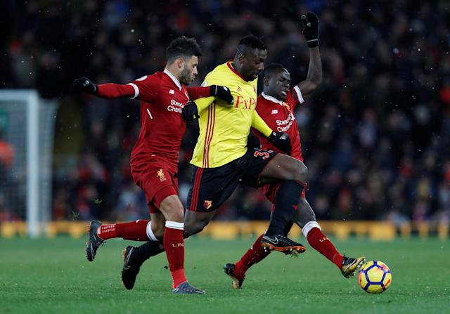 "Soccer Football - Premier League - Liverpool vs Watford - Anfield, Liverpool, Britain - March 17, 2018 Watford's Stefano Okaka in action with Liverpool's Alex Oxlade-Chamberlain and Sadio Mane Action Images via Reuters/Lee Smith EDITORIAL USE ONLY. No use with unauthorized audio, video, data, fixture lists, club/league logos or ""live"" services. Online in-match use limited to 75 images, no video emulation. No use in betting, games or single club/league/player publications. Please contact your account representative for further details."