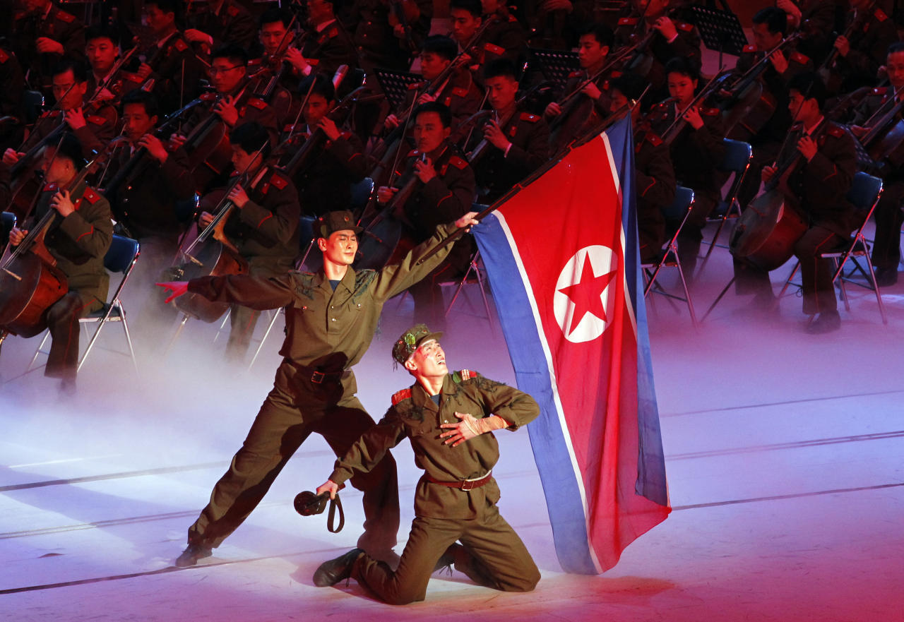 North Korean military performers take part in a concert on the eve of the 80th anniversary of the founding of the North Korean army in Pyongyang, North Korea, Tuesday, April 24, 2012. (AP Photo/Ng Han Guan)