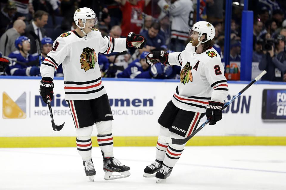 Chicago Blackhawks left wing Dominik Kubalik (8) celebrates his goal against the Tampa Bay Lightning with defenseman Duncan Keith (2) during the third period of an NHL hockey game Thursday, Feb. 27, 2020, in Tampa, Fla. (AP Photo/Chris O'Meara)