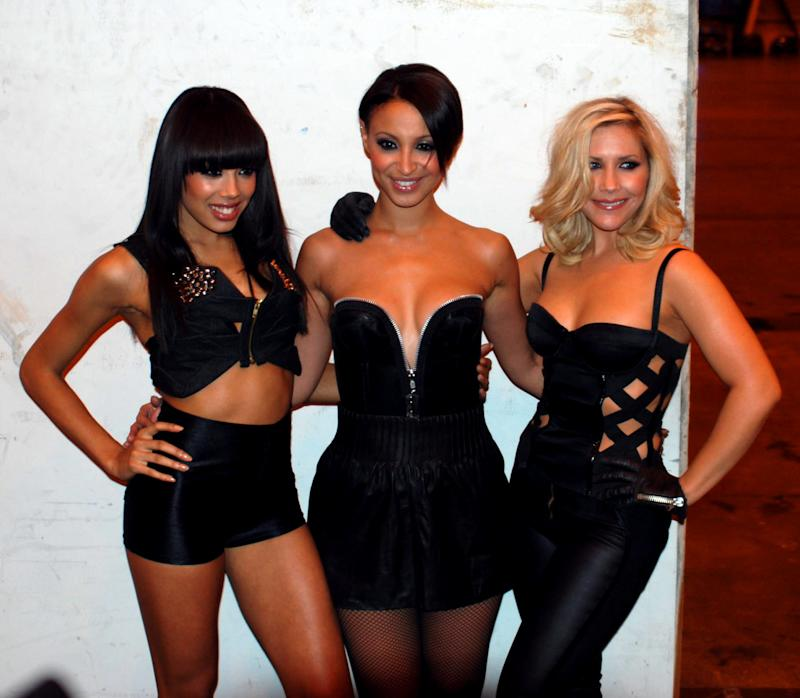 British singers Jade Ewen, Amelle Berrabah and Heidi Range from The Sugababes at T4's Stars of 2009 in central London, Sunday, Nov. 29, 2009. (AP Photo/Mike Eccleshall)