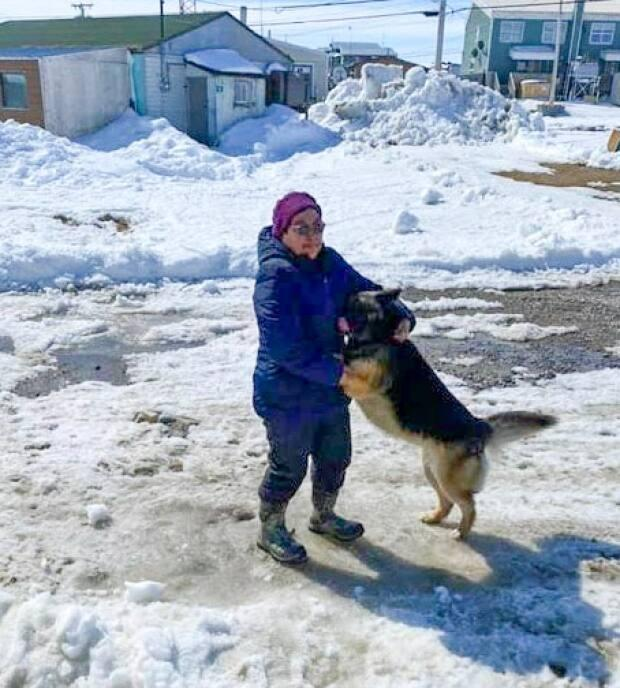 Donna Adams reunites with her dog, Pepper, in Whale Cove, Nunavut. Days earlier, Pepper had gone missing back home in Rankin Inlet, about 70 kilometres away. (Submitted by Donna Adams - image credit)