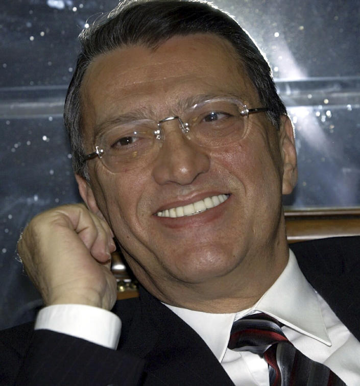 FILE - In this Wednesday, Feb. 16, 2005 file photo, Turkish politician Mesut Yilmaz smiles before the start of his trial at the Supreme Court in Ankara, Turkey. Yilmaz, a former Turkish prime minister and veteran politician who served as premier three times during a tumultuous political era in his country, died Friday, Oct. 30, 2020, at age 72, official Anadolu news agency said. (AP Photo/Burhan Ozbilici, File)