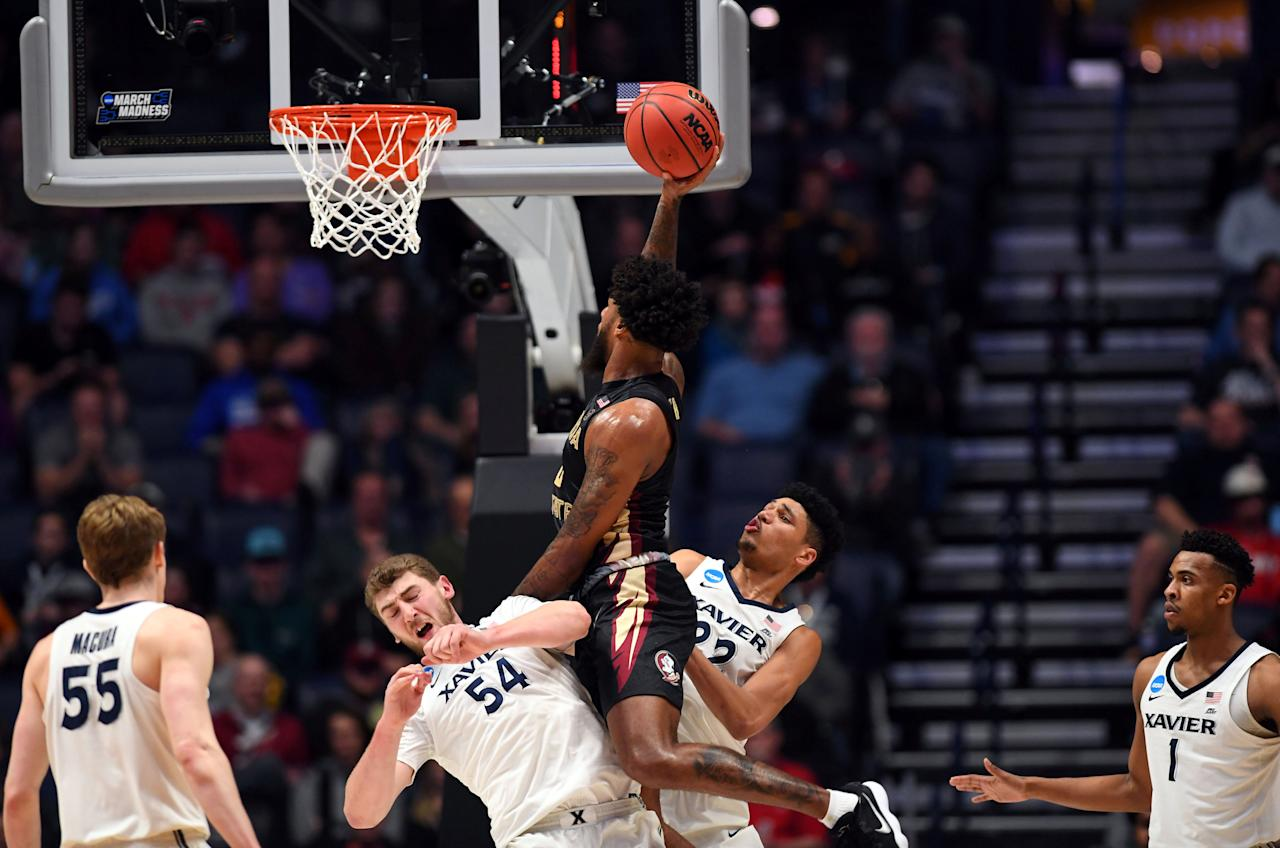 Mar 18, 2018; Nashville, TN, USA; Florida State Seminoles forward Phil Cofer (0) shoots against Xavier Musketeers forward Sean O'Mara (54) and forward Kaiser Gates (22) during the second half in the second round of the 2018 NCAA Tournament at Bridgestone Arena. Mandatory Credit: Christopher Hanewinckel-USA TODAY Sports     TPX IMAGES OF THE DAY