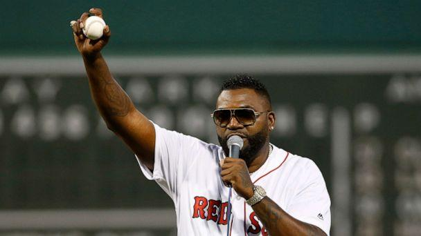 PHOTO: Former Boston Red Sox player David Ortiz talks to the crowd after throwing out the ceremonial first pitch before the game against the New York Yankees at Fenway Park in Boston, Sep 9, 2019. (Greg M. Cooper/USA TODAY Sports via Reuters)