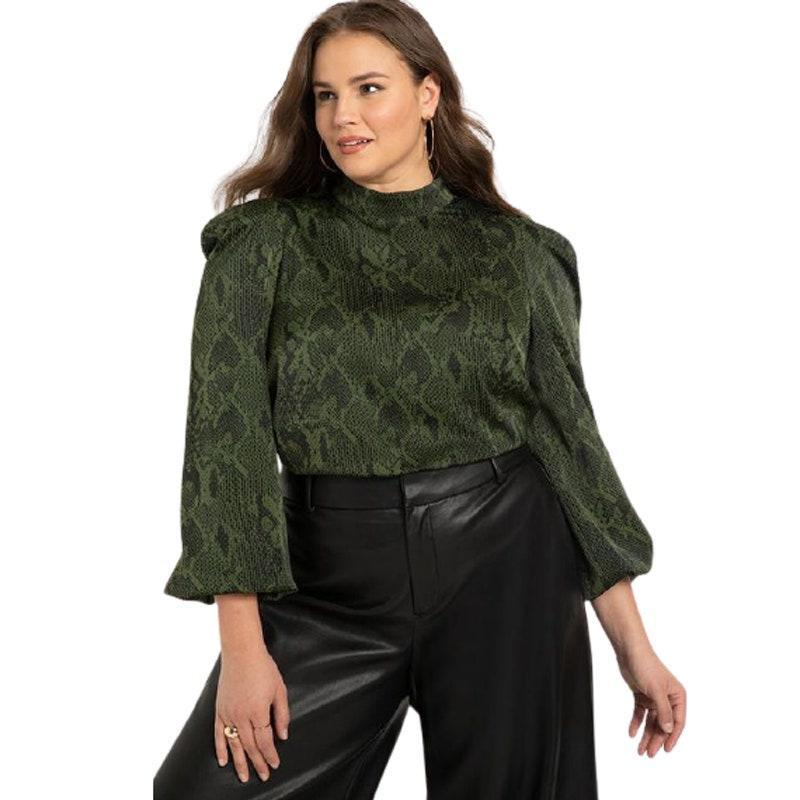 """Looking for something that's on-trend? Eloquii has got your back. Prepare yourself to find some super cute styles, ranging from maxi dresses to faux leather jackets to adorable work 'fits and more. TBH, it's one-stop shopping if you're trying to build an entire wardrobe that's both cool <em>and</em> functional. $70, Eloquii. <a href=""""https://www.eloquii.com/puff-shoulder-mock-neck-blouse/1062393.html?dwvar_1062393_colorCode=6&index=1&item_list_id=plp_category_page&item_list_name=Category%20Page"""" rel=""""nofollow noopener"""" target=""""_blank"""" data-ylk=""""slk:Get it now!"""" class=""""link rapid-noclick-resp"""">Get it now!</a>"""