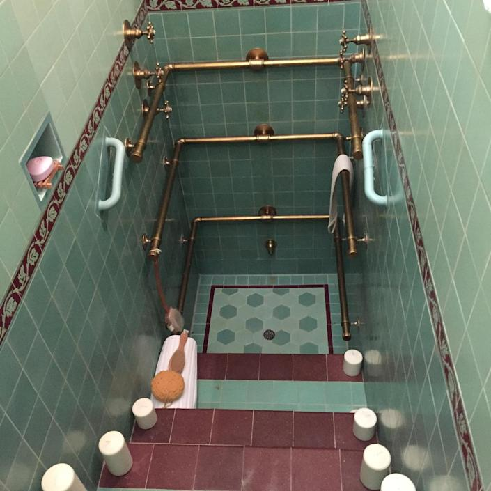 <p>This step-down shower is a unique touch. The horizontal pipes you see all function, spraying water.</p>