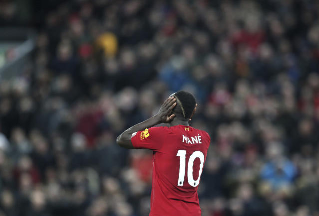 Liverpool's Sadio Mane reacts during the English Premier League soccer match between Liverpool and Everton at Anfield Stadium, Liverpool, England, Wednesday, Dec. 4, 2019. (AP Photo/Jon Super)