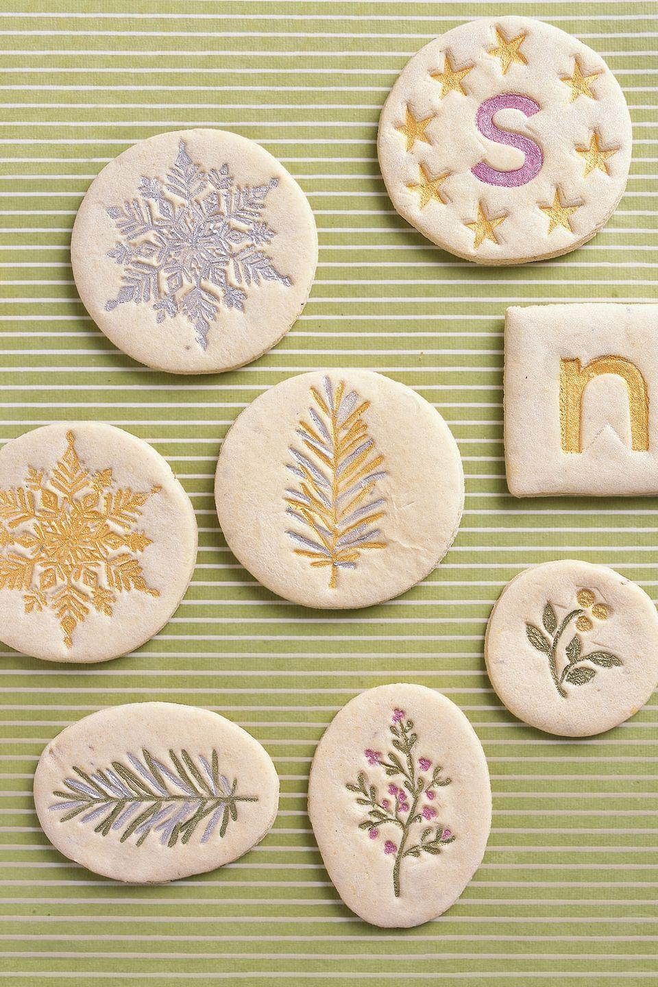 "<p>Bavarian cookies called <em>springerle</em> are known for their distinctive flavor. The dough is rolled onto a floured surface, imprinted with clean, floured rubber stamps, dried overnight, and then baked.</p><p><strong><a href=""https://www.countryliving.com/food-drinks/recipes/a1897/springerle-4361/?magazine=countryliving"" rel=""nofollow noopener"" target=""_blank"" data-ylk=""slk:Get the recipe"" class=""link rapid-noclick-resp"">Get the recipe</a>.</strong></p><p><a class=""link rapid-noclick-resp"" href=""https://go.redirectingat.com?id=74968X1596630&url=https%3A%2F%2Fwww.etsy.com%2Flisting%2F843183962%2Fchristmas-tree-stamps-snowflake-stamps&sref=https%3A%2F%2Fwww.countryliving.com%2Ffood-drinks%2Fg2777%2Fchristmas-sugar-cookies%2F"" rel=""nofollow noopener"" target=""_blank"" data-ylk=""slk:SHOP STAMPS"">SHOP STAMPS</a><br></p>"