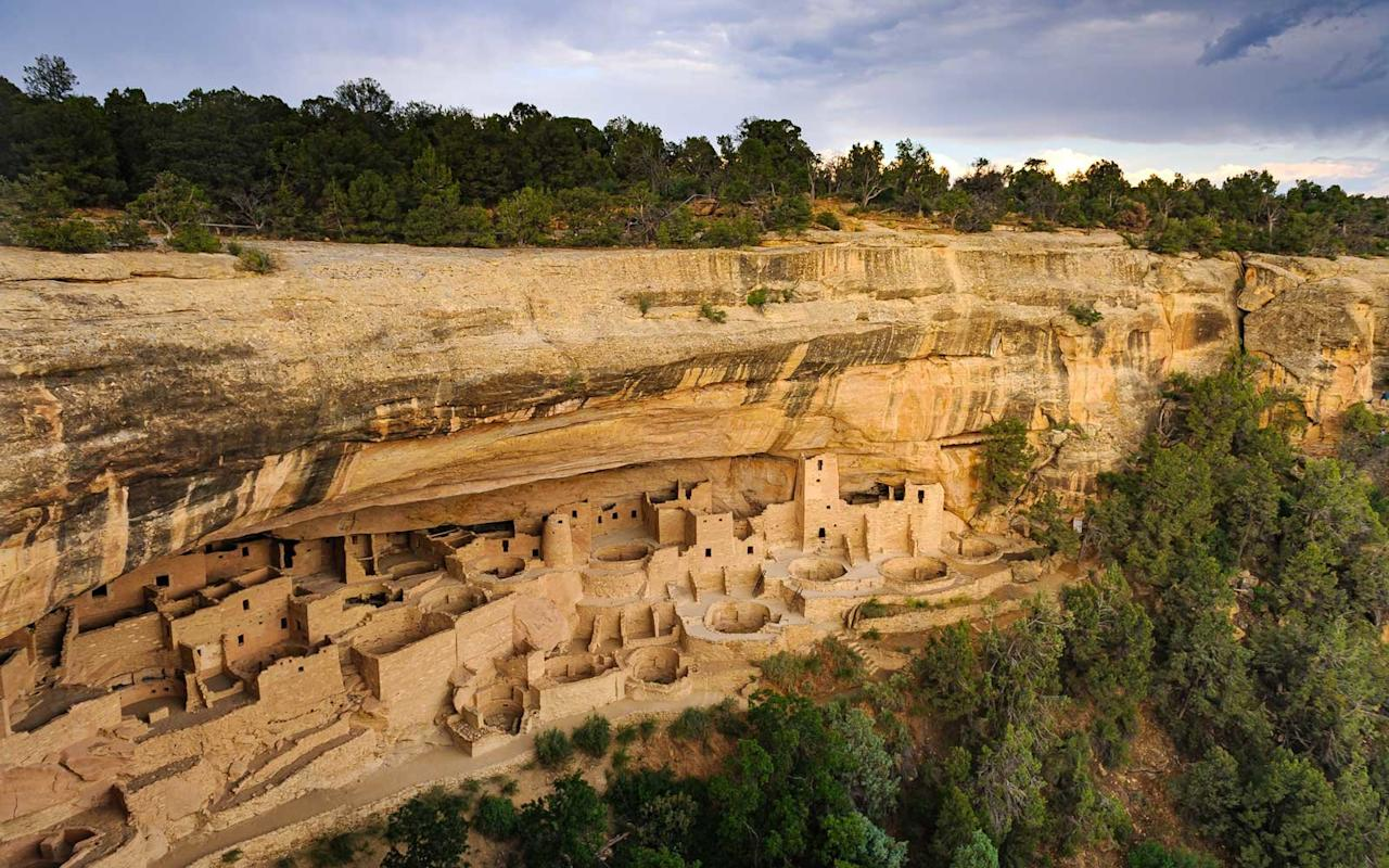 """<p>With 5,000 archeological sites and 600 cliff dwellings, <a href=""""https://www.nps.gov/meve/index.htm"""">Mesa Verde National Park</a> is one of the most significant Native American sites in the United States. Home to the Ancestral Pueblo people who lived there between 600 to 1300 CE, the park is best recognizable by a rock-cut city built into the cliffs of Colorado. With 40+ miles of roads and numerous hiking trails, it's the perfect place to learn about one of the United States' most ancient civilizations on Native American Heritage Day and their ancestors, today's modern Pueblo people. </p>"""
