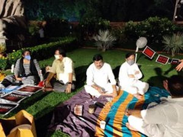 The eight suspended MPs spending the night on Parliament lawn (Photo source: Ripun Bora's Twitter)