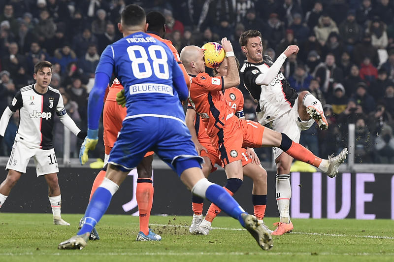 Juventus' Daniele Rugani, right, in action during the Italian Cup soccer match between Juventus and Udinese, at the Allianz Stadium in Turin, Italy, Wednesday, Jan. 15, 2020. (Fabio Ferrari/LaPress via AP)