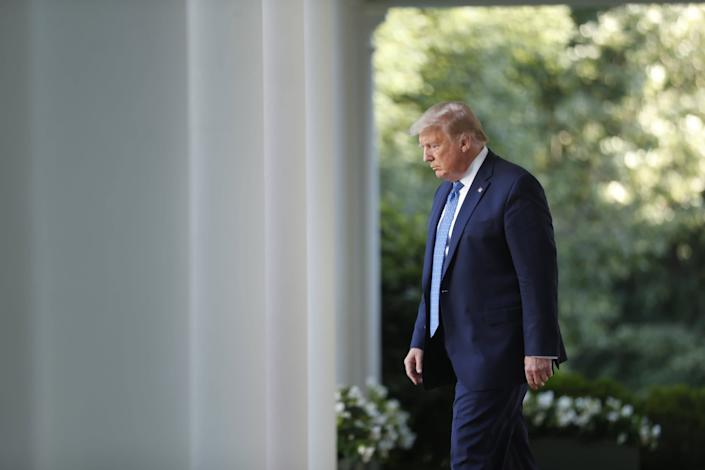 Donald Trump arrives in the Rose Garden of the White House to make a statement threatening to deploy the US military to crush George Floyd protests: EPA