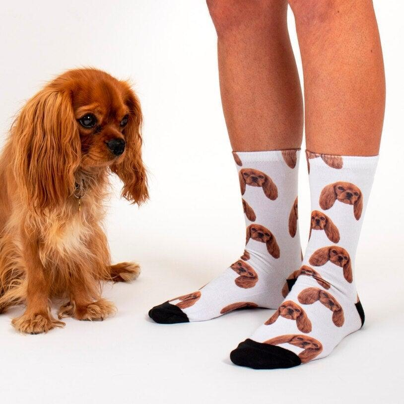 """<h3><a href=""""https://www.firebox.com/Sock-Your-Pet-Personalised-Pet-Socks/p9076"""" rel=""""nofollow noopener"""" target=""""_blank"""" data-ylk=""""slk:Firebox Personalized Socks"""" class=""""link rapid-noclick-resp"""">Firebox Personalized Socks</a></h3><br>For a completely ridiculous but equally awesome personalized gift, UK gift site Firebox has you covered. They've got <a href=""""https://www.firebox.com/personalised/t67?via=catbar&page=1"""" rel=""""nofollow noopener"""" target=""""_blank"""" data-ylk=""""slk:32 products you can customize"""" class=""""link rapid-noclick-resp"""">32 products you can customize</a> with your face, your sibling's face, perhaps even the family dog's smushed mug. <br><br><strong>Firebox</strong> Sock Your Pet – Personalised Pet Socks, $, available at <a href=""""https://go.skimresources.com/?id=30283X879131&url=https%3A%2F%2Fwww.firebox.com%2FSock-Your-Pet-Personalised-Pet-Socks%2Fp9076"""" rel=""""nofollow noopener"""" target=""""_blank"""" data-ylk=""""slk:Firebox"""" class=""""link rapid-noclick-resp"""">Firebox</a>"""