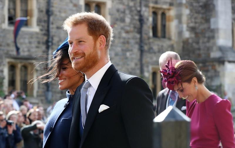 PW2DPE The Duchess of Sussex, the Duke of Sussex, and the Duchess of Cambridge after the wedding of Princess Eugenie to Jack Brooksbank at St George's Chapel in Windsor Castle.