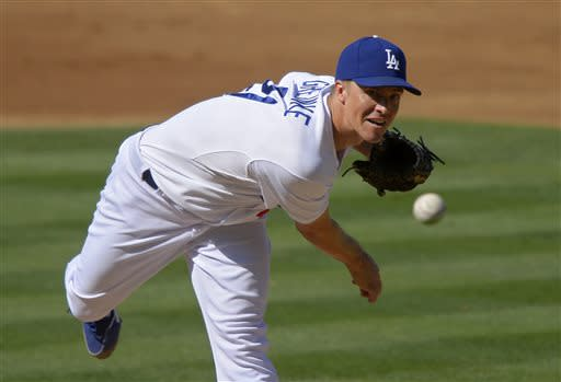 Los Angeles Dodgers starting pitcher Zack Greinke throws to the plate during the second inning of a baseball game against the Colorado Rockies, Saturday, July 13, 2013 in Los Angeles. (AP Photo/Mark J. Terrill)