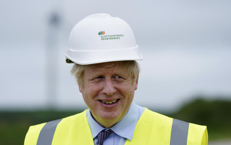 Britain's Prime Minister Boris Johnson gestures during a visit to the Scottish Power Carland Cross Windfarm in Newquay, Cornwall on June 9, 2021, where he viewed new construction on a solar farm. (Photo by Jon Super / POOL / AFP) (Photo by JON SUPER/POOL/AFP via Getty Images)