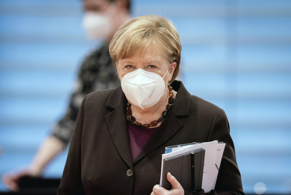 German Chancellor Angela Merkel wearsa face mask as she arrives for the weeekly cabinet meeting at the Chancellery in Berlin, Germany, Wednesday, Feb. 24, 2021. (Kay Nietfeld/dpa via AP, Pool)
