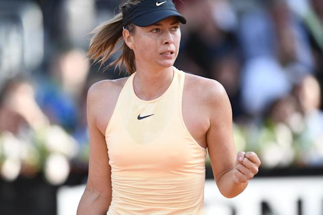 Quarter-final spot: Maria Sharapova on her way to victory over Daria Gavrilova (AFP Photo/Filippo MONTEFORTE)