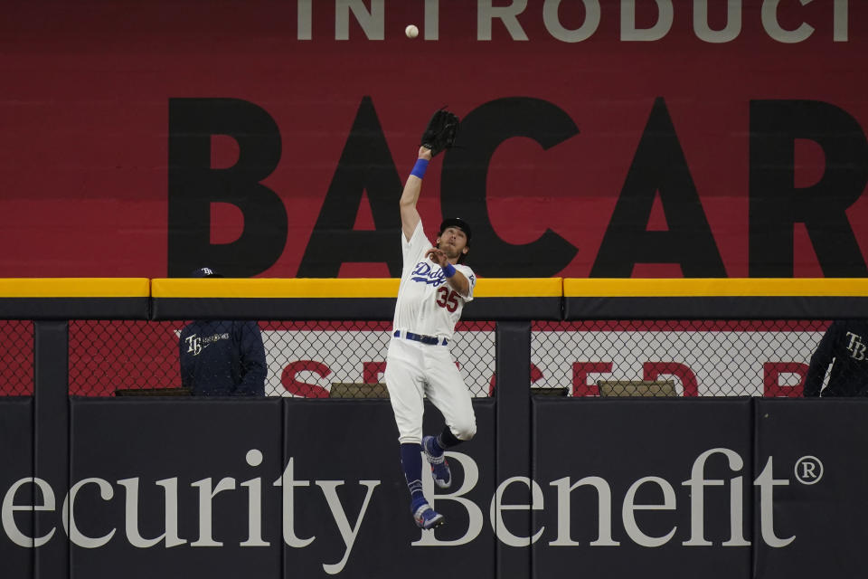Los Angeles Dodgers center fielder Cody Bellinger catches a fly ball hit by Tampa Bay Rays' Austin Meadows during the ninth inning in Game 1 of the baseball World Series Tuesday, Oct. 20, 2020, in Arlington, Texas. (AP Photo/Eric Gay)