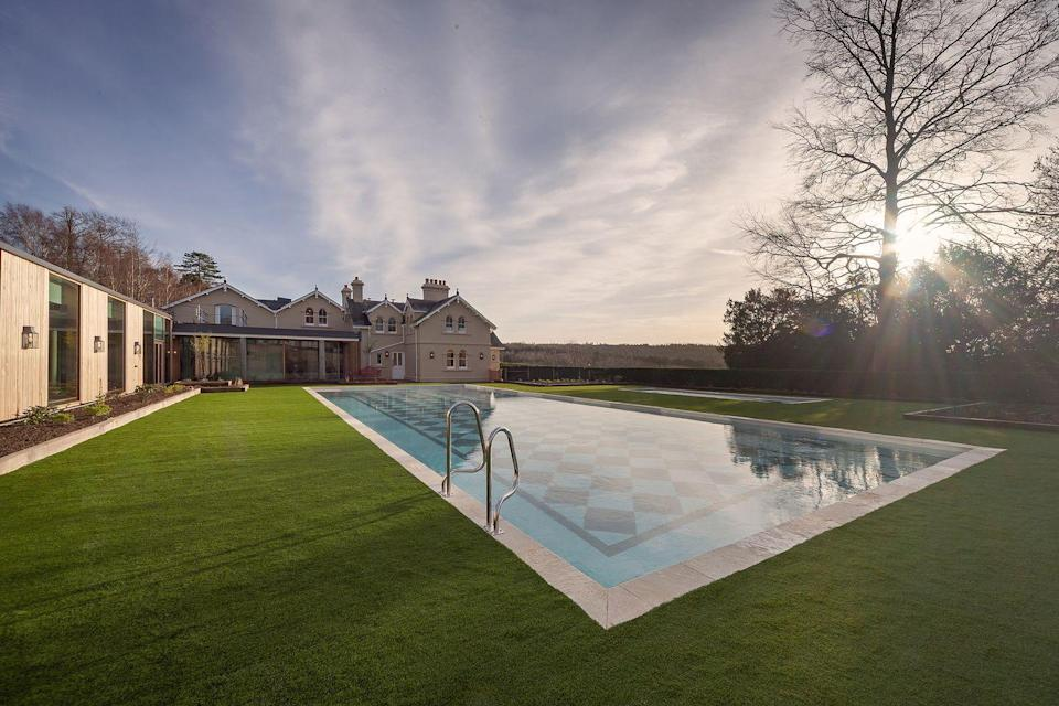 """<p>If the roaring Twenties had a spiritual home, it was this Surrey address - and the glamorous country house hotel's outdoor pool is the perfect place from which to soak up the history of the place. </p><p>The summer-ready outdoor pool has views of the rolling Surrey Hills where <a href=""""https://go.redirectingat.com?id=127X1599956&url=https%3A%2F%2Fwww.booking.com%2Fhotel%2Fgb%2Fthe-garden-house-leatherhead.en-gb.html&sref=https%3A%2F%2Fwww.harpersbazaar.com%2Fuk%2Ftravel%2Fg33508196%2Fhotels-with-outdoor-pools%2F"""" rel=""""nofollow noopener"""" target=""""_blank"""" data-ylk=""""slk:Beaverbrook"""" class=""""link rapid-noclick-resp"""">Beaverbrook</a> is located and is the only place you'll want to spend time on balmy evenings. There's another, more child-friendly pool for little ones and a 20-metre indoor pool in case the weather turns.</p><p>Its indoor pool is particularly worth a dip in for its scattering of cornflower insets on the pool floor, which creates a magical effect.</p><p><a class=""""link rapid-noclick-resp"""" href=""""https://go.redirectingat.com?id=127X1599956&url=https%3A%2F%2Fwww.booking.com%2Fhotel%2Fgb%2Fthe-garden-house-leatherhead.en-gb.html&sref=https%3A%2F%2Fwww.harpersbazaar.com%2Fuk%2Ftravel%2Fg33508196%2Fhotels-with-outdoor-pools%2F"""" rel=""""nofollow noopener"""" target=""""_blank"""" data-ylk=""""slk:BOOK NOW"""">BOOK NOW</a><br></p>"""