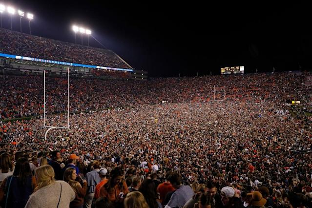 Fans swarm the field after the Iron Bowl. (Getty)
