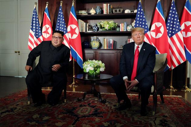 US President Donald Trump and North Korea's leader Kim Jong Un meet in a one-on-one bilateral session at the start of their summit at the Capella Hotel on the resort island of Sentosa, Singapore June 12, 2018.