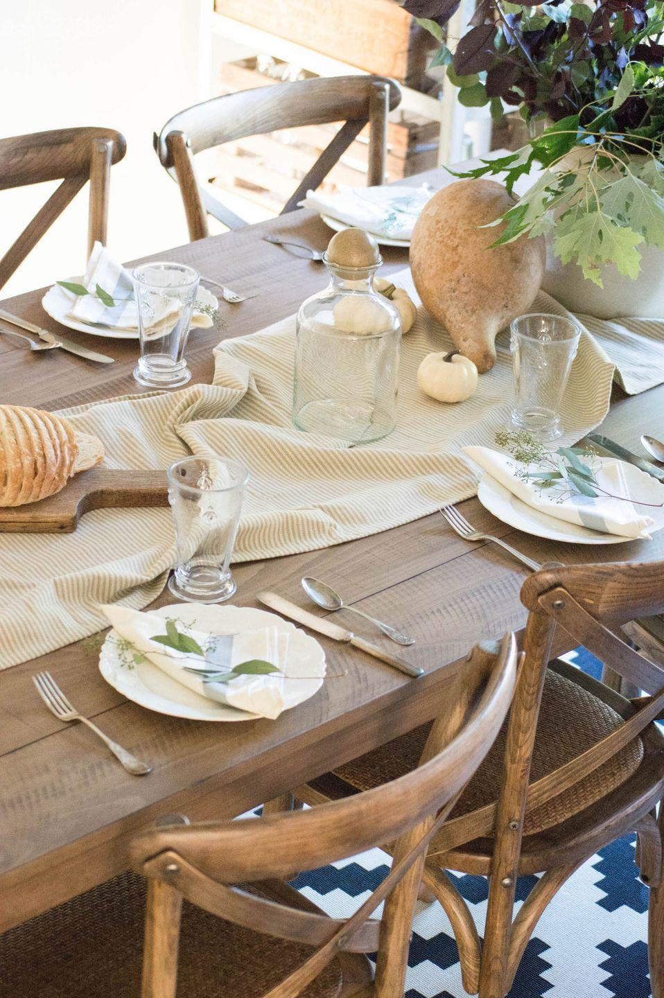 """<p>Create a relaxed yet <a href=""""https://www.elledecor.com/life-culture/entertaining/g3288/best-wedding-tables/"""" rel=""""nofollow noopener"""" target=""""_blank"""" data-ylk=""""slk:elegant tablescape"""" class=""""link rapid-noclick-resp"""">elegant tablescape</a> by ruffling a neutral table runner and accenting it with small gourds, as in this dining room table from <a href=""""http://www.unexpectedelegance.com/5-ways-to-update-your-dining-room-table/"""" rel=""""nofollow noopener"""" target=""""_blank"""" data-ylk=""""slk:Unexpected Elegance"""" class=""""link rapid-noclick-resp"""">Unexpected Elegance</a>. </p>"""
