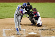 Los Angeles Dodgers Edwin Rios hits a home run against the Atlanta Braves during the third inning in Game 4 of a baseball National League Championship Series Thursday, Oct. 15, 2020, in Arlington, Texas. (AP Photo/Sue Ogrocki)