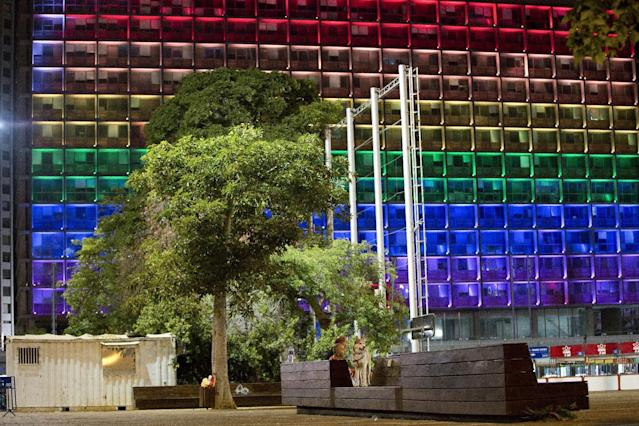 <p>Tel-Aviv city hall lit up with rainbow flag colors in solidarity with Florida's shooting attack victims, in Tel Aviv, Israel, June 12, 2016. (AP Photo/Oded Balilty) </p>