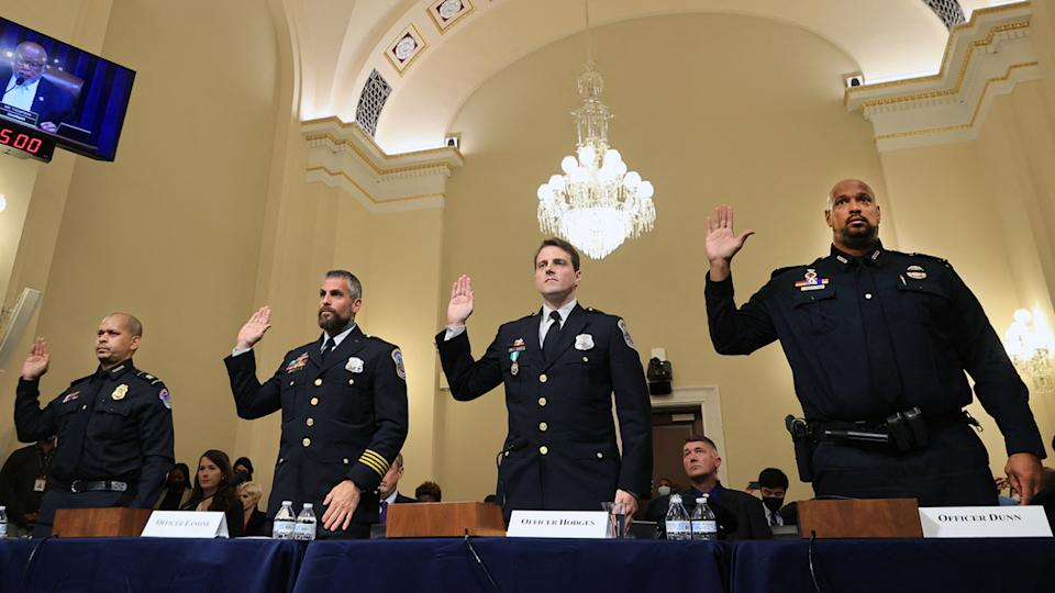 L-R) US Capitol Police officer Sgt. Aquilino Gonell, DC Metropolitan Police Department officer Michael Fanone, DC Metropolitan Police Department officer Daniel Hodges and US Capitol Police officer Harry Dunn are sworn in prior to testifying during the Select Committee investigation of the January 6, 2021, attack on the US Capitol, during their first hearing on Capitol Hill in Washington, DC, on July 27, 2021.(Chip Somodevilla/AFP via Getty Images)