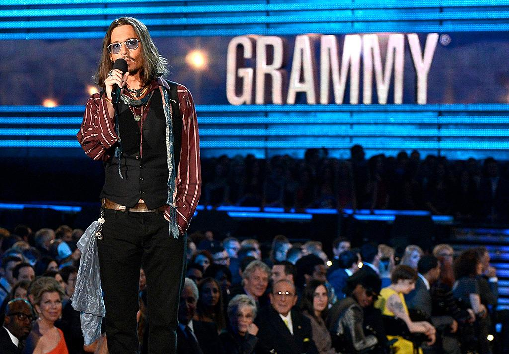 Johnny Depp, at the Grammys? Yes, the actor showed up to introduce Mumford and Sons - he is apparently a big fan and has been spotted hanging out with Marcus Mumford.