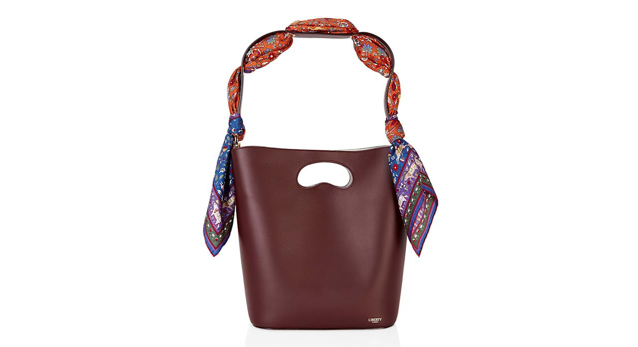 "<p>Combining two classics (a Liberty scarf and a bucket bag), this beautiful leather bag is just what you need to take your wardrobe to the next level. It might come with a hefty price tag, but it will last you forever. <em><a rel=""nofollow"" href=""https://www.libertylondon.com/uk/sophia-leather-bucket-bag-with-imran-silk-scarf-R262773006.html?dwvar_000615494_color=74-BURGUNDY&listsrc=Bags#start=1"">Shop now.</a></em> </p>"